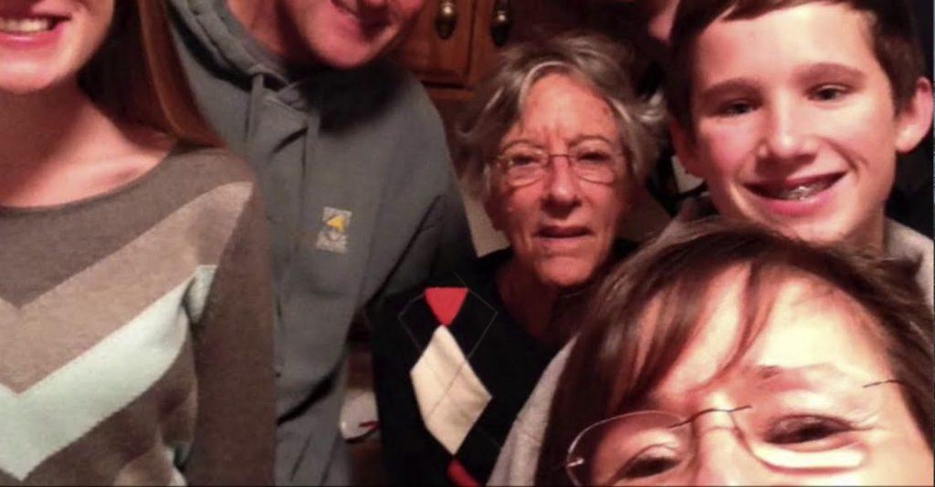 Charter Senior Living of Jackson Video Thumbnail Family Group Surrounded by senior living resident
